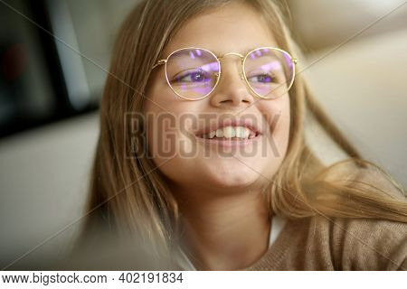 Portrait of 10-year-old blond girl with eyeglasses