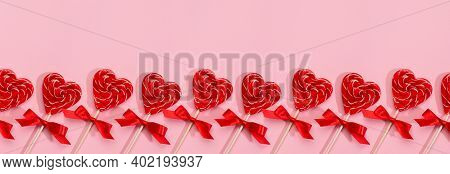 Gentle Valentine's Day Banner - Sweet Red Lollipops Hearts On Pastel Pink As Seamless Border, Layout