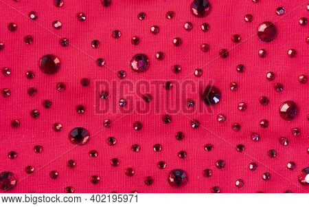 Pink Knitted Fabric With Many Rhinestones Pattern. Fashion Cloth Background Texture