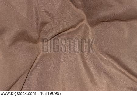 Close up shot of wrinkled satin fabric for background use