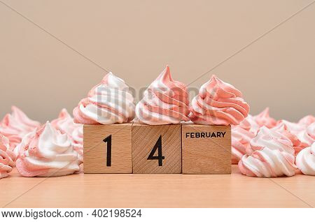 14 February On Wooden Blocks Displayed With Pink And White Meringues