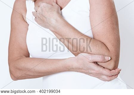 A Woman Has A Pain In Her Arm.