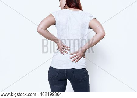 The Woman Has A Pain In Her Back.