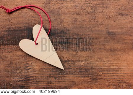 Blank Wooden Heart For Painting Or Decoupage On Wooden Table Background. Top View. Valentines Day Co