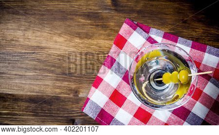 Drink Martini. Martini With Olives On A Wooden Table. Free Space For Text. Top View
