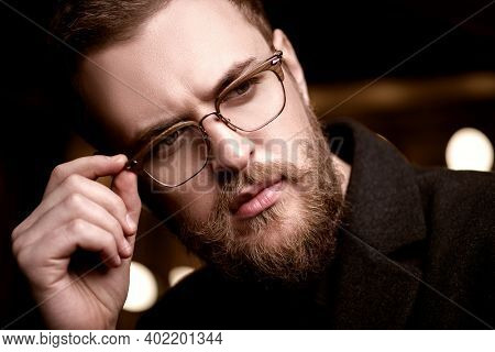 Optics for men. Businessman portrait.  Stylish handsome man wearing glasses.