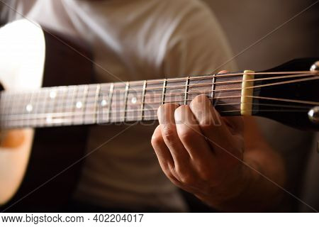 Acoustic Guitar Fingerboard Detail And Hands Playing Doing A D Major Chord