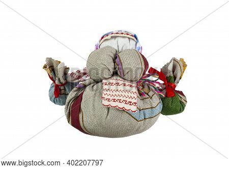 Traditional Russian Doll. The Doll Holds Two Bundles In Her Hands. Home Creativity. Isolated Doll On