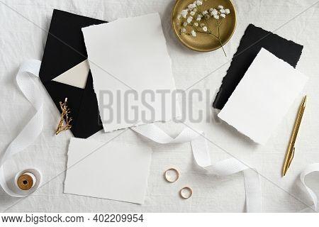 Wedding Invitation Cards Design. Set Of Blank Paper Cards, Black Envelopes, Golden Decorations On Wh