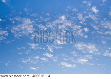 Blue Clean Sky With White Clouds Background