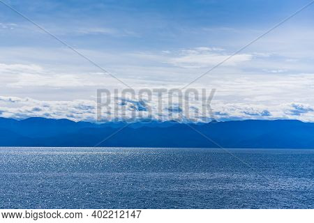 Landscape Of Lake Baikal Sky, Clouds And Mountains