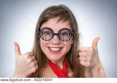 Young Funny Geek Or Nerd Woman Isolated On Gray Background