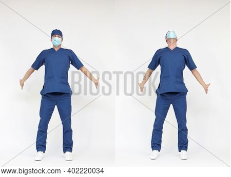 Standing male medical professional stretching arms and back