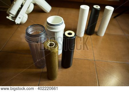 Changing Filters In Your Home Water Purification System. The Master Replaces The Gut Filter In The C