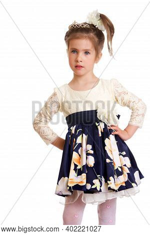 Charming Girl Holding The Hem Of Her Dress. Beautiful Happy Kid Dressed Nice Dress And White Tights