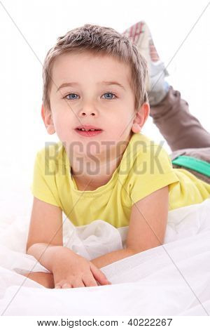 Portrait of cute little boy isolated on a white background