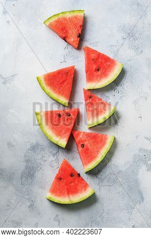 Slices Of Fresh Watermelon With Ice On A Blue Concrete Background. Detox And Vegetarian Concept. Top