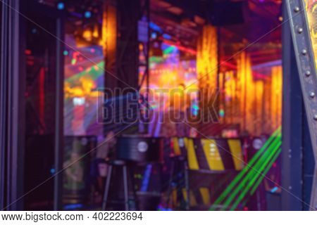 Blurred Night Club With Disco Lights.  Abstract Defocused Background Of Colorful Interior. Dj Plays