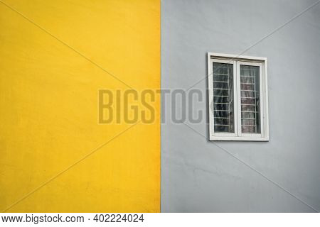 Yellow And Gray Outdoor Wall With Window. Outside Wall Duotone Color.