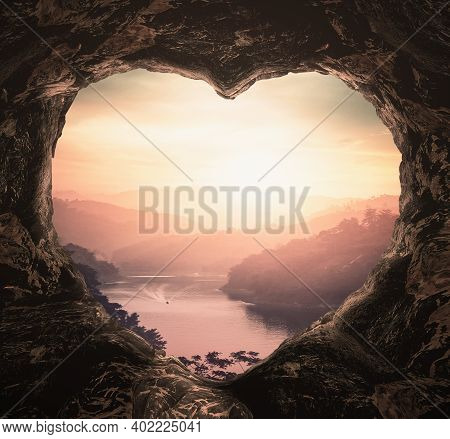 Heart Shape Of Cave On River And Mountains Sunset Background