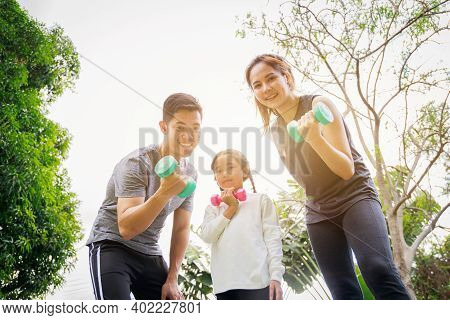 Fit Happy People Working Out Outdoor. Portrait Family Asian Parent And Child Daughter Exercising Tog