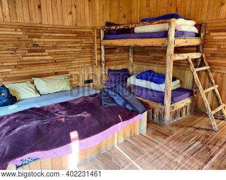 Photograph Of Bunk Beds Inside A Wooden Cottage