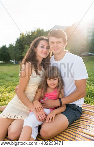 Happy Family, Woman Mom With Man Dad Daughter 5-6 Years Old, Summer In Park Grass Sit Blanket, Happy