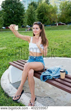 Happy Woman City Summer Smiles Rejoices, Sits Bench Takes Pictures Smartphone, Online Recording On I
