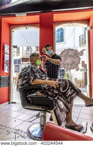 Silves,portugal - August 14, 2020: Man With Mask At The Hair Dresser With Corona Mask In A Local Hai
