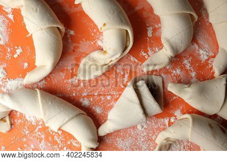 Producing Classic Croissants. Crescent Rolls Before Baking. Croissants On A Tray. French Pastry Good