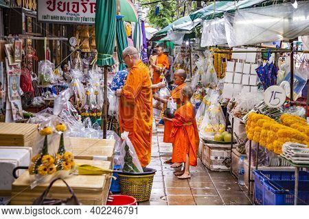 Bangkok, Thailand - May 12, 2009: Monks Get Their Morning Gift At The Nightly Flower Market Pak Klon