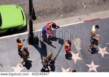 Hollywood, Usa - July 5, 2008: Actors Are Dressed As Hollywood Doubles  Like Spiderman And Offer Pho