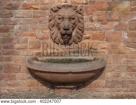 Well With Lion Head Seen In Miltenberg, A Town In Lower Franconia, Bavaria, Germany
