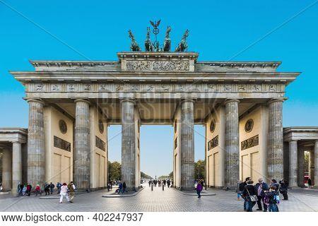 Berlin, Germany - October 27, 2014: People Enjoy The Sunset At The Brandenburg Gate At Street Unter