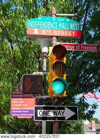 Philadelphia, Usa - June 11, 2019: A Traffic Light With Signposts Attached Near Independence Nationa