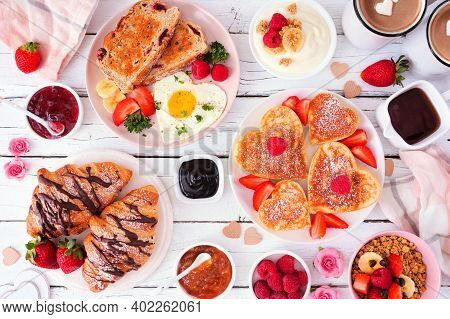 Valentines Or Mothers Day Brunch Table Scene. Overhead View On A White Wood Background. Heart Shaped