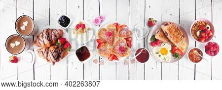 Valentines Or Mothers Day Breakfast Table Scene. Above View On A White Wood Banner Background. Heart