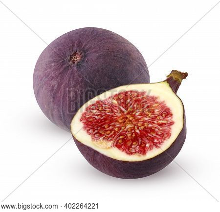 Isolated Figs. One And A Half Figs Isolated On A White Background With A Clipping Path. Purple Fruit
