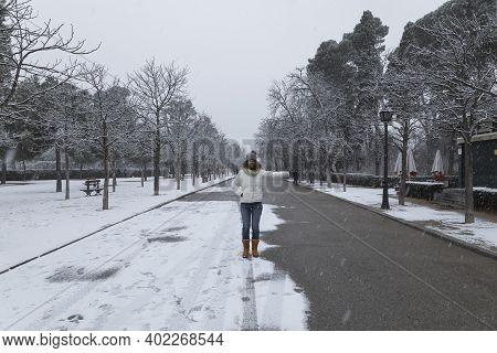 Madrid, Spain - January 07, 2021: A Young Girl Enjoys A Walk Through The Buen Retiro Park In Madrid,