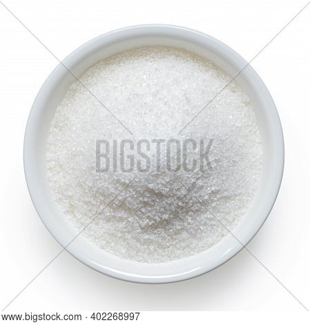Refined Granulated Sugar In White Ceramic Bowl Isolated On White. Top View.