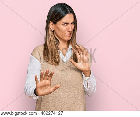 Young woman wearing casual clothes disgusted expression, displeased and fearful doing disgust face because aversion reaction. with hands raised