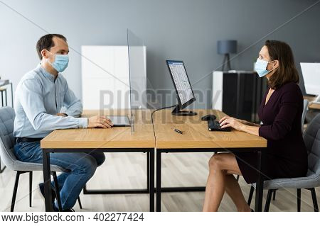 Business Meeting With Sneeze Guard Social Distancing