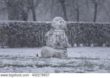 Madrid, Spain - January 07, 2021: Snowmen Made By Some Kids, In The Buen Retiro Park In Madrid, In T