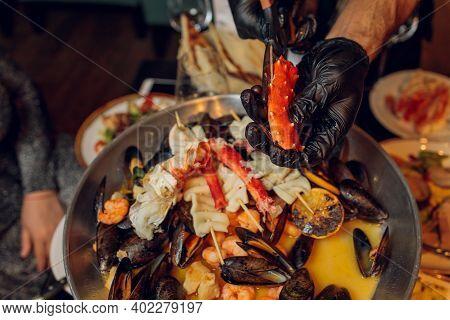 Hand Of Chef Cleaning And Preparing Fresh Raw Giant Mud Crab, Serrated Mud Crabs Scylla Serrata Read