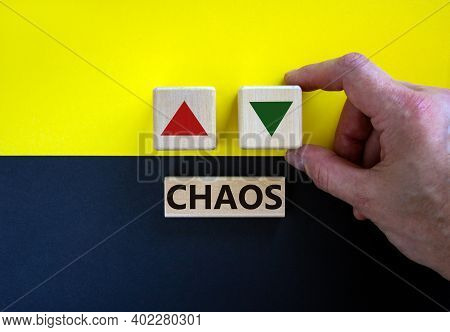 Time To Chaos. Businessman Holds A Cubes With Up Icon. Wooden Cubes With Word 'chaos'. Beautiful Yel