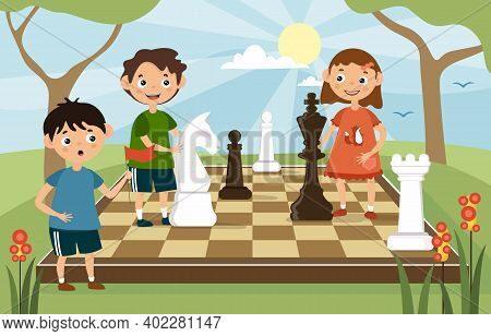 Young Children Playing A Game Of Chess Outdoors With Large Chess Pieces On A Board Amongst Trees, Ca
