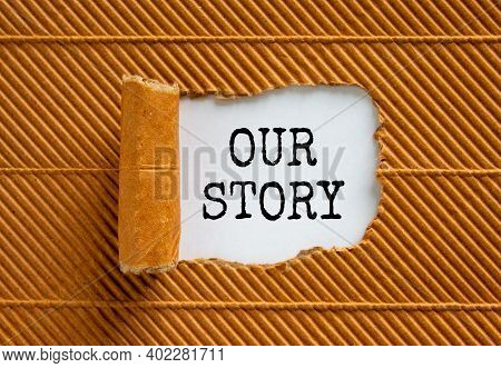 Our Story Symbol. Words 'our Story' Appearing Behind Torn Brown Paper. Business And Our Story Concep