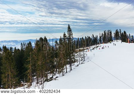 Ski Resort In High Tatry, Slovakia. Winter Mountain Landscape.  Beautiful Cloudy Sky.