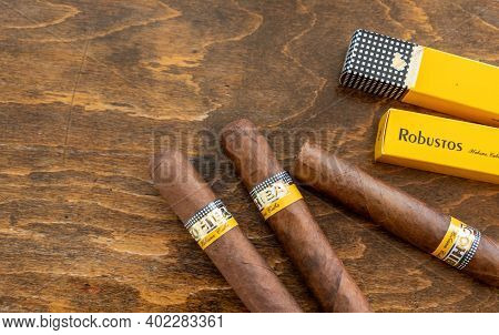 Cuban Cigars Cohiba Robustos On Wooden Desk, Top View