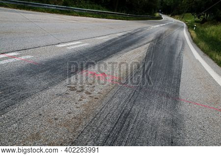 The Rubber Tracks From The Racing Cars Left On The Tarmac At The Start Of The Hill Climb Stage.